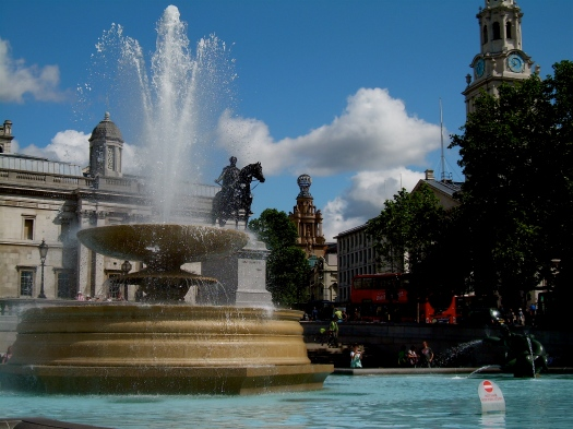 Trafalgar Square with Double Decker Bus in Background